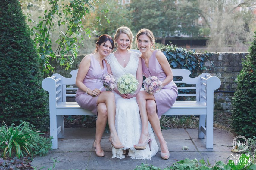 bride and bridesmaids on bench